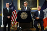 New York City Police Commissioner James O'Neill, left, listens as his successor, Chief of Detectives Dermot Shea, center, speaks at New York City Hall, while New York Mayor Bill de Blasio looks on, Monday, Nov. 4, 2019. New York City's police commissioner is retiring after three years in charge of the nation's largest police department, Mayor Bill de Blasio said Monday. (AP Photo/Richard Drew)