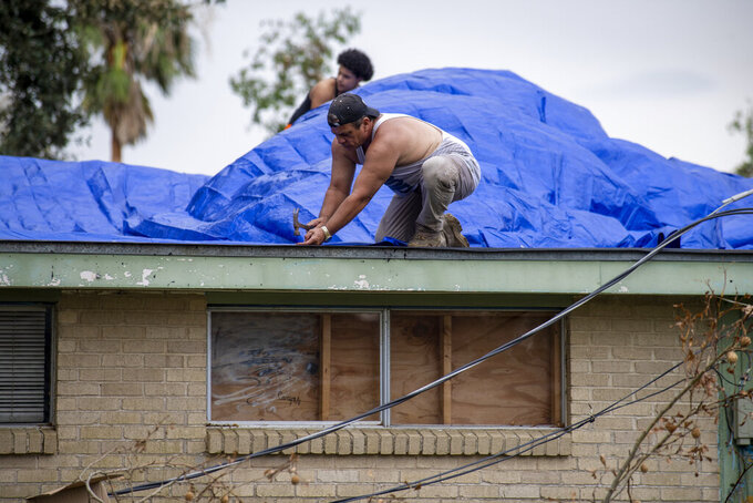 A roof is covered with tarps on Monday, Sept. 6, 2021, in Kenner, La., a week after Hurricane Ida swept through the area. (Chris Granger/The Times-Picayune/The New Orleans Advocate via AP)