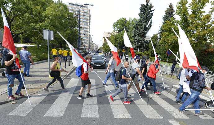 Polish farmers take part in a demonstration against a proposed ban on fur farms and kosher meat exports in Warsaw, Poland, Wednesday, Sept. 16, 2020. (AP Photo/Czarek Sokolowski)