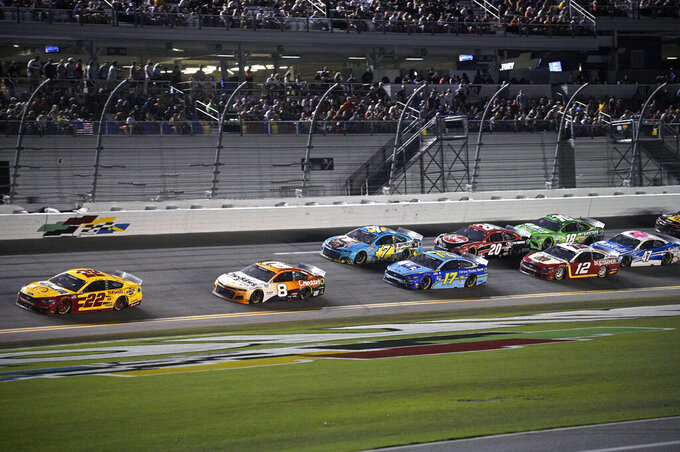 Joey Logano (22) leads a pack of cars through the front stretch during a NASCAR Cup Series auto race at Daytona International Speedway, Saturday, Aug. 28, 2021, in Daytona Beach, Fla. (AP Photo/Phelan M. Ebenhack)