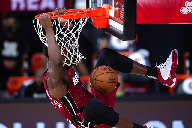 Miami Heat's Bam Adebayo dunks during the first half of an NBA basketball game against the Phoenix Suns, Saturday, Aug. 8, 2020 in Lake Buena Vista, Fla. (AP Photo/Ashley Landis, Pool)