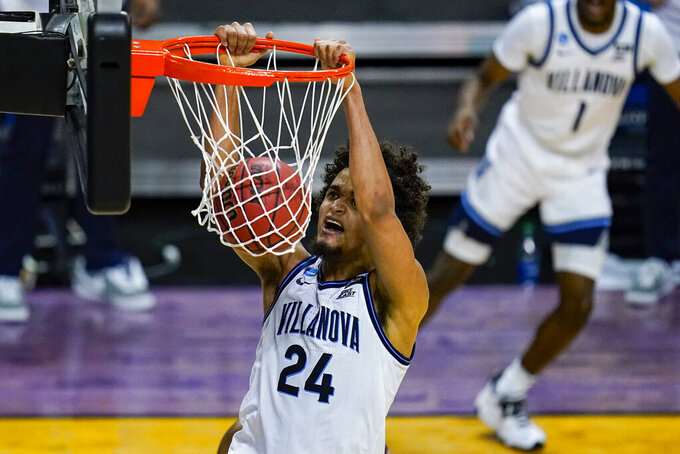 Villanova forward Jeremiah Robinson-Earl (24) get a basket on a dunk against Winthrop in the second half of a first round game in the NCAA men's college basketball tournament at Farmers Coliseum in Indianapolis, Saturday, March 20, 2021. (AP Photo/Michael Conroy)