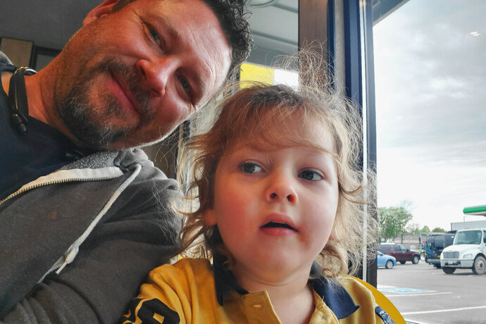 In this Saturday, Aug. 24, 2019 photo provided by George Hendrickson, George takes a selfie photo with his 7-year-old son, Eliyah, at a Sioux Falls, S.D. restaurant. Eliyah has been diagnosed with Dravet syndrome and his father would like to see the state approve medical marijuana to aid in his treatment. Volunteers are gathering signatures to get an initiated measure on the November ballot. (Photo by George Hendrickson)
