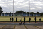 Soldiers hold a flag-raising ceremony outside the president's official residence, Alvorada Palace, in Brasilia, Brazil, Wednesday, July 8, 2020. President Jair Bolsonaro said Tuesday he tested positive for COVID-19. (AP Photo/Eraldo Peres)