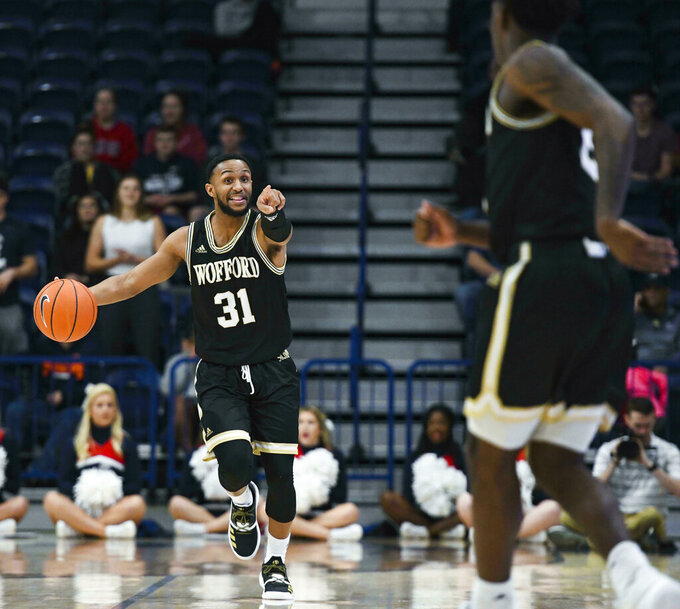 Wofford guard Donovan Theme-Love (31) calls a play during the first half of an NCAA college basketball game against Samford Saturday, March 2, 2019, in Birmingham, Ala. (AP Photo/Julie Bennett)