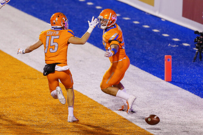 Boise State linebacker DJ Schramm (52) and wide receiver Maclaine Griffin (15) celebrate a touchdown by Schramm after a blocked Colorado State punt during the first half in an NCAA college football game Thursday, Nov. 12, 2020, in Boise, Idaho. (AP Photo/Steve Conner)