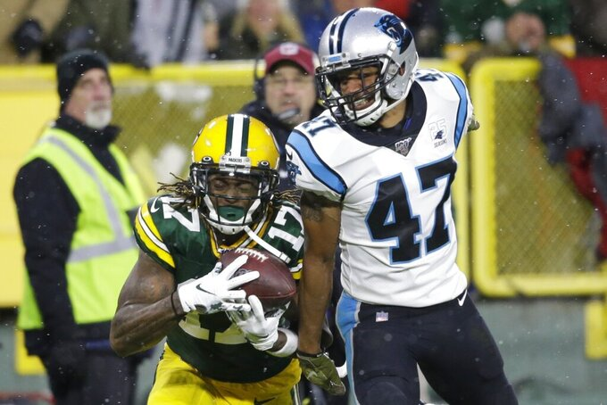 Green Bay Packers' Davante Adams catches a pass in front of Carolina Panthers' Ross Cockrell during the first half of an NFL football game Sunday, Nov. 10, 2019, in Green Bay, Wis. (AP Photo/Jeffrey Phelps)