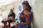 Fatima Li, 20, foreground, holds her two-year-old son, Hama Sow, as he is treated with a feeding tube for malnourishment, as Hadiara Ouedraogo, left, sits with her granddaughter, Fatimata Ouedrago, 2, who has edema due to severe malnourishment, at Yalgado Ouedraogo University in Ouagadougou, Burkina Faso on Monday, June 22, 2020. In Burkina Faso one in five young children is chronically malnourished. Food prices have spiked, and 12 million of the country's 20 million residents don't get enough to eat. (AP Photo/Sam Mednick)