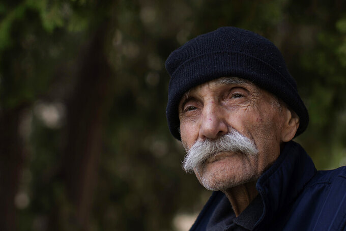 Abu Omar, 81, poses for a photograph at the Social Services Medical Association, a rehabilitation hospital and nursing home in the northern city of Tripoli, Lebanon, Thursday, June 10, 2021. With virtually no national welfare system, Lebanon's elderly are left to fend for themselves amid their country's economic turmoil. In their prime years, they survived 15 years of civil war that started in 1975 and bouts of instability. Now, in their old age, many have been thrown into poverty by one of the world's worst financial crises in the past 150 years. (AP Photo/Hassan Ammar)