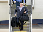 FILE - In this June 8, 2018, file photo, Washington Capitals head coach Barry Trotz arrives with the team at Dulles International Airport in Sterling, Va., the day after defeating the Vegas Golden Knights in Game 5 of the NHL hockey Stanley Cup Finals. Trotz has resigned as coach of the Washington Capitals after leading them to the Stanley Cup.  The team announced Trotz's resignation Monday, June 18, 2018. (AP Photo/Andrew Harnik, File)