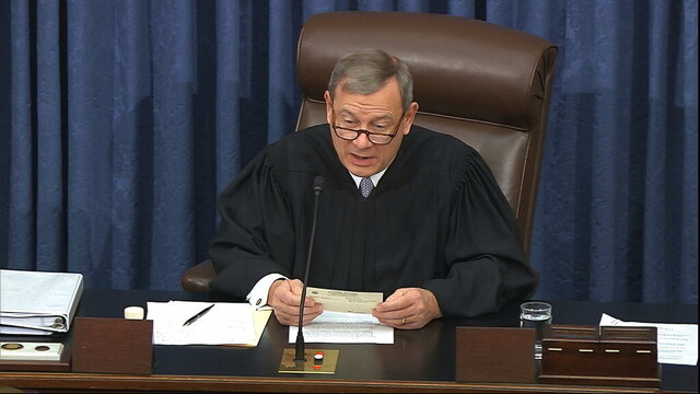 In this image from video, presiding officer Chief Justice of the United States John Roberts reads a question during the impeachment trial against President Donald Trump in the Senate at the U.S. Capitol in Washington, Thursday, Jan. 30 2020. (Senate Television via AP)