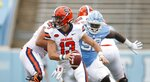Syracuse quarterback Tommy DeVito (13) scrambles to avoid North Carolina defender Jahlil Taylor (52) in first half of an NCAA college football game, Saturday, Sept. 12, 2020 in Chapel Hill, N.C.(Robert Willett/The News & Observer via AP, Pool)