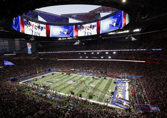 New England Patriots take the field, bottom right, before the NFL Super Bowl 53 football game between the Los Angeles Rams and the New England Patriots Sunday, Feb. 3, 2019, in Atlanta. (AP Photo/Tim Donnelly)