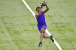 Clemson football player Tee Higgins catches a pass while running drills during NFL Pro Day Thursday, March 12, 2020, in Clemson, S.C. (AP Photo/Richard Shiro)