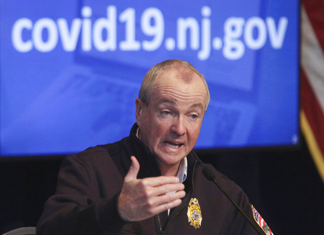 FILE- In this April 25, 2020 file photo, New Jersey Gov. Phil Murphy speaks during his daily press briefing at the the War Memorial in Trenton, N.J. Murphy signed legislation on Thursday, July 16, 2020, authorizing nearly $10 billion in debt to plug budget holes brought on by the coronavirus pandemic, but Republicans sued him, arguing the bill runs afoul of the state constitution. (Chris Pedota/The Record via AP, File)