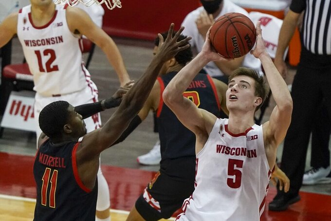 Wisconsin's Tyler Wahl shoots past Maryland's Darryl Morsell during the second half of an NCAA college basketball game Monday, Dec. 28, 2020, in Madison, Wis. (AP Photo/Morry Gash)