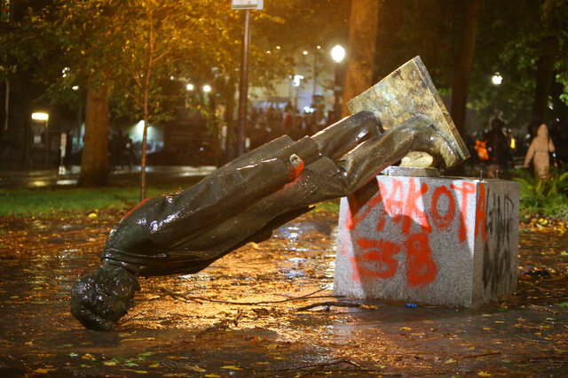 A group of protesters toppled statues of former presidents Theodore Roosevelt and Abraham Lincoln in Portland's South Park Block late Sunday, Oct. 11, 2020. (Sean Meagher/The Oregonian via AP)
