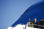 President Donald Trump waves as he arrives at Moffett Federal Airfield to attend a fundraiser, Tuesday, Sept. 17, 2019, in Mountain View, Calif. (AP Photo/Evan Vucci)