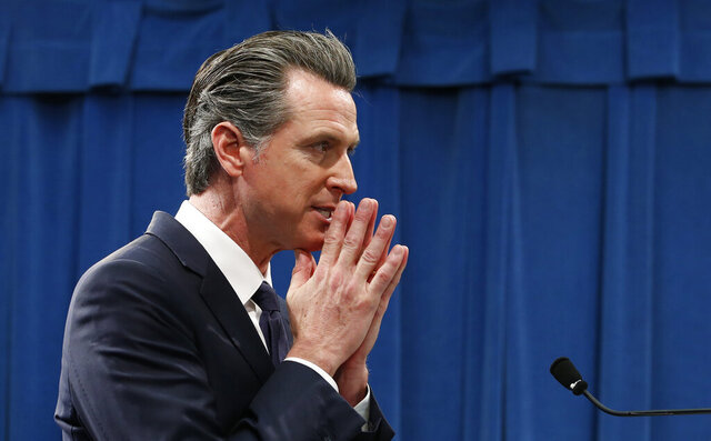 California Gov. Gavin Newsom listens to a question concerning his proposed 2020-2021 state budget during a news conference in Sacramento, Calif., Friday, Jan. 10, 2020.. (AP Photo/Rich Pedroncelli)
