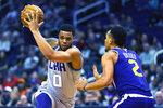 Charlotte Hornets forward Miles Bridges drives on Phoenix Suns forward Elie Okobo (2) during the first half of an NBA basketball game Sunday, Jan. 12, 2020, in Phoenix. (AP Photo/Rick Scuteri)