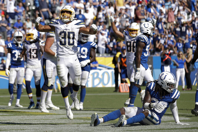 Ekeler scores 3 TDs in Chargers' 30-24 OT win over Colts