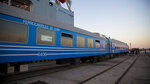 In this Monday, May 20, 2019 photo, new railroad passenger cars brought from China are inspected at their arrival in Havana, Cuba. Cuba's Ministry of Transportation took possession of 80 new Chinese-made passenger cars, part of a promised consignment of 250 rail cars and locomotives the island will receive by year's end. (Irene Perez/Cubadebate via AP)