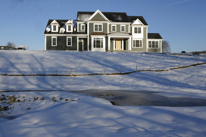 FILE- In this Feb. 21, 2019, file photo a recently constructed home is surrounded by snow in Natick, Mass. On Thursday, March 21, Freddie Mac reports on this week's average U.S. mortgage rates. (AP Photo/Steven Senne, File)