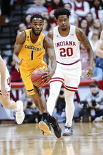 Wichita State forward Markis McDuffie (1) brings the ball up court in front of Indiana forward De'Ron Davis (20) in the first half of an NCAA college basketball game in the third round of the NIT tournament in Bloomington, Ind., Tuesday, March 26, 2019. Wichita State won 73-63. (AP Photo/AJ Mast)