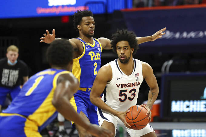 Virginia guard Trey Murphy III (25) looks for an opening during an NCAA college basketball game against Pittsburgh, Saturday, Feb. 6, 2021, in Charlottesville, Va. (Erin Edgerton/The Daily Progress via AP, Pool)