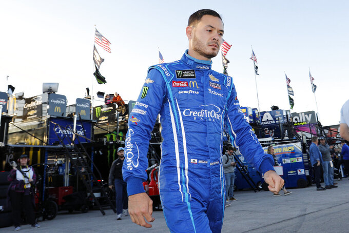 FILE - In this Oct. 18, 2019, file photo, Kyle Larson walks to the garage before the final practice for a NASCAR Cup Series auto race at Kansas Speedway in Kansas City, Kan. Kyle Larson used a racial slur on a live stream Sunday. April 12, 2020, during a virtual race — the second driver in a week to draw scrutiny while using the online racing platform to fill time during the coronavirus pandemic. (AP Photo/Colin E. Braley, File)