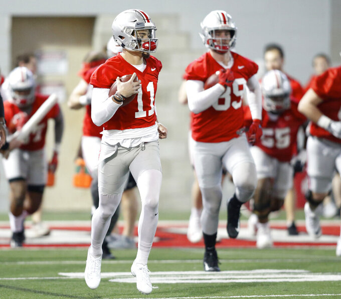 Ohio State wide receiver Austin Mack, left, and tight end Luke Farrell run through a drill during spring NCAA college football practice in Columbus, Ohio, Wednesday, March 6, 2019. (AP Photo/Paul Vernon)