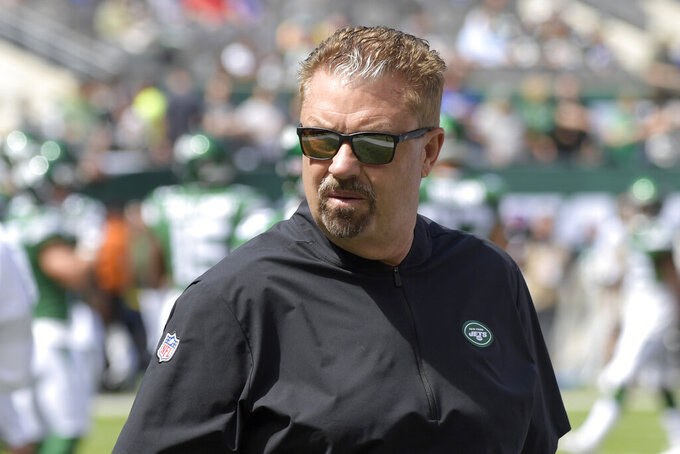 FILE - In this Sept. 8, 2019, file photo, New York Jets defensive coordinator Gregg Williams looks on before an NFL football game against the Buffalo Bills, in East Rutherford, N.J. Gregg Williams has made a career of adjusting on the fly, mixing and matching players to regularly field one of the NFL's toughest defenses. The New York Jets defensive coordinator certainly has his hands full this season after losing his two best players with Jamal Adams traded, and C.J. Mosley choosing to opt out because of the coronavirus pandemic. But, in typical fashion, Williams isn't sweating it - at all. (AP Photo/Bill Kostroun, File)