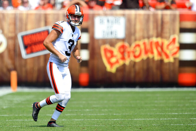 Cleveland Browns kicker Chase McLaughlin runs on the field to attempt an extra point in the third quarter of an NFL preseason football game against the New York Giants, Sunday, Aug. 22, 2021, in Cleveland. Browns kicker Cody Parkey is being placed on injured reserve, meaning McLaughlin will likely begin the season as Cleveland's starter. (AP Photo/David Richard)