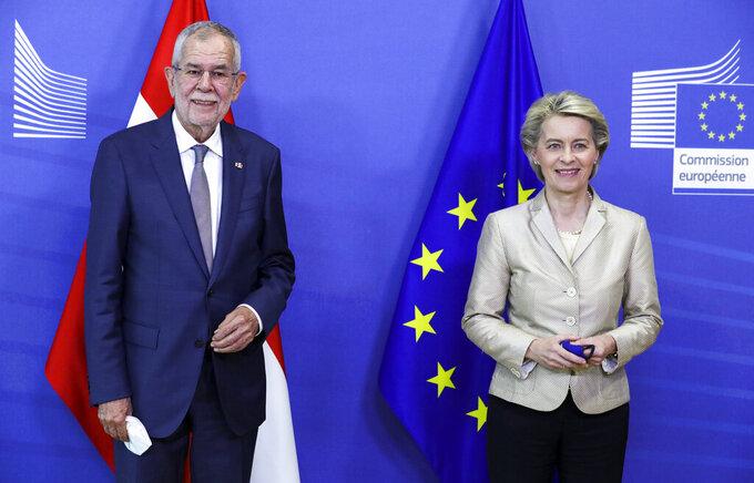 European Commission President Ursula von der Leyen, right, welcomes Austrian President Alexander Van der Bellen at EU headquarters in Brussels, Tuesday, July 13, 2021. (Pascal Rossignol, Pool Photo via AP)