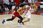 Nebraska's Trey McGowens, left, tries to drive past Ohio State's C.J. Walker during the second half of an NCAA college basketball game Wednesday, Dec. 30, 2020, in Columbus, Ohio. (AP Photo/Jay LaPrete)