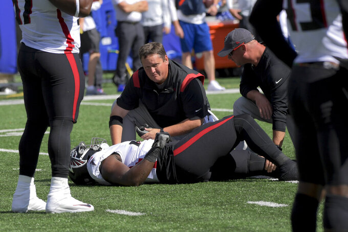 Atlanta Falcons defensive end Marlon Davidson lies on the field after an apparent injury during the first half of an NFL football game against the New York Giants, Sunday, Sept. 26, 2021, in East Rutherford, N.J. (AP Photo/Bill Kostroun)