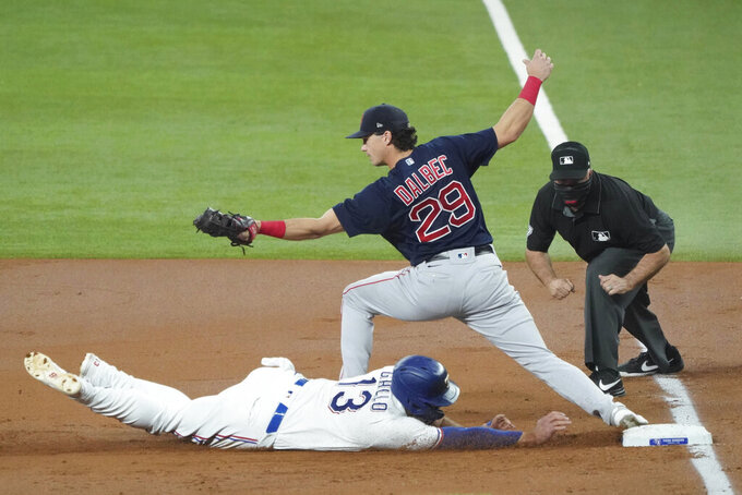 Texas Rangers' Joey Gallo is doubled off first base on a fly ball as Boston Red Sox first baseman Bobby Dalbec takes the throw in the first inning of a baseball game in Arlington, Texas, Saturday, May 1, 2021. (AP Photo/Louis DeLuca)