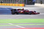 Ferrari driver Charles Leclerc of Monaco steers his car during the qualifying session at the Baku Formula One city circuit in Baku, Azerbaijan, Saturday, June 5, 2021. The Azerbaijan Formula One Grand Prix will take place on Sunday. (AP Photo/Darko Vojinovic)