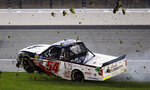 Driver Natalie Decker spins into the infield grass during the NASCAR Truck Series auto race at Kansas Speedway in Kansas City, Kan., Friday, May 10, 2019. (AP Photo/Colin E. Braley)