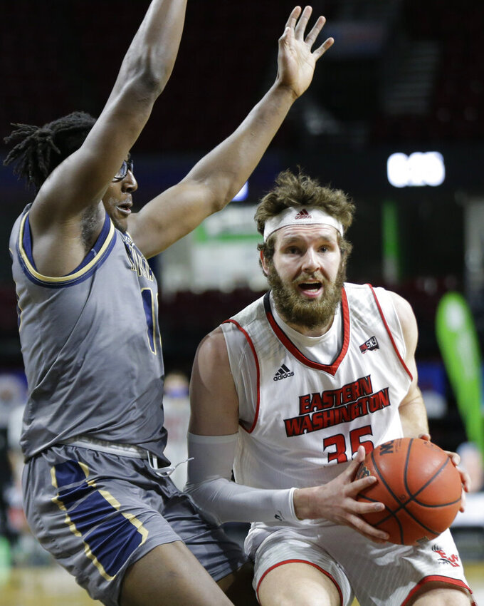 Eastern Washington forward Tanner Groves (35) moves the ball around Montana State forward Jubrile Belo during an NCAA college basketball game for the championship of the Big Sky men's tournament in Boise, Idaho, Saturday, March 13, 2021. Eastern Washington won 65-55. (AP Photo/Otto Kitsinger)