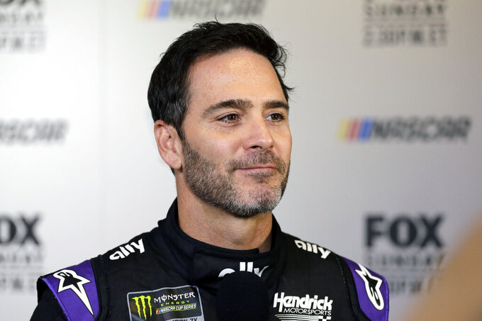 "FILE - In this Feb. 13, 2019, file photo, driver Jimmie Johnson smiles during media day for the NASCAR Daytona 500 auto race at Daytona International Speedway in Daytona Beach, Fla.  As he prepares for his final season of full-time racing, the most accomplished driver of his generation has changed his mindset. ""I'm not chasing anything,"" said Johnson, who is determined to enjoy his 19th and final Cup season. (AP Photo/Terry Renna, File)"
