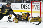 Vegas Golden Knights goaltender Marc-Andre Fleury (29) makes a save against the Colorado Avalanche as Vegas Golden Knights defenseman Zach Whitecloud (2) watches during the third period in Game 6 of an NHL hockey Stanley Cup second-round playoff series Thursday, June 10, 2021, in Las Vegas. (AP Photo/John Locher)