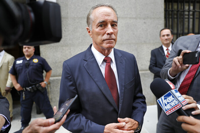 FILE - In this Sept. 12, 2019 file photo, U.S. Rep. Chris Collins, R-N.Y., speaks to reporters as he leaves the courthouse after a pretrial hearing in his insider-trading case, in New York. Collins is resigning from his seat ahead of an expected guilty plea in an insider trading case in which he was accused of leaking confidential information during an urgent phone call made from a White House picnic. Collins submitted a resignation letter Monday, Sept. 30, 2019 according to a spokesman for House Speaker Nancy Pelosi. It will take effect when Congress meets in a brief session on Tuesday. (AP Photo/Seth Wenig, File)
