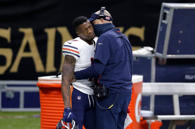 Chicago Bears wide receiver Anthony Miller reacts as head coach Matt Nagy talks to him, after he was ejected for unsportsmanlike conduct in the second half of an NFL wild-card playoff football game against the New Orleans Saints in New Orleans, Sunday, Jan. 10, 2021. (AP Photo/Brett Duke)