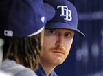 FILE - In this Oct. 1, 2017, file photo, Tampa Bay Rays pitchers Chris Archer, left, and Alex Cobb, right, talk in the dugout during the fifth inning of a baseball game against the Baltimore Orioles, in St. Petersburg, Fla.  In a historically slow market, players and management are feuding publicly about riches and rules, and teams seemingly are seeking bargains like shoppers awaiting a closeout.  Job-seekers include pitchers Alex Cobb and Lance Lynn; reliever Greg Holland; infielder Eduardo Nunez; outfielders Carlos Gomez and Carlos Gonzalez; and catcher Jonathan Lucroy.(AP Photo/Steve Nesius, File)