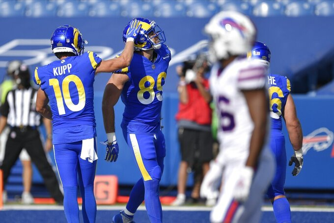Los Angeles Rams' Cooper Kupp (10) celebrates with Tyler Higbee (89) after Higbee scored the point after try during the second half of an NFL football game against the Buffalo Bills Sunday, Sept. 27, 2020, in Orchard Park, N.Y. (AP Photo/Adrian Kraus)