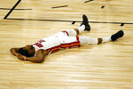 Miami Heat's Jimmy Butler lays on the court after drawing a foul against the Denver Nuggets during the first half of an NBA basketball game, Saturday, Aug. 1, 2020, in Lake Buena Vista, Fla. (Kevin C. Cox/Pool Photo via AP)