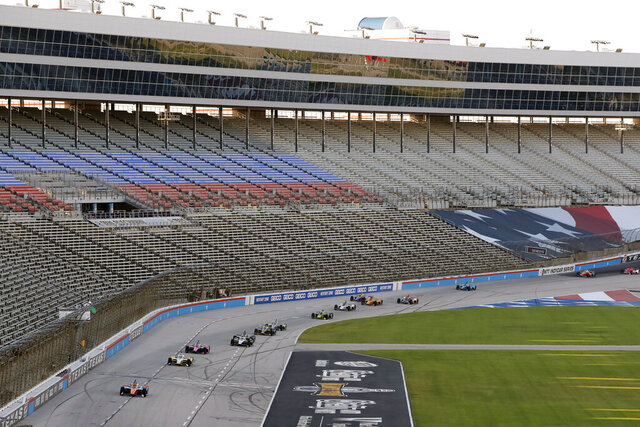 Drivers come head onto the front stretch during an IndyCar auto race restart following a crash at Texas Motor Speedway in Fort Worth, Texas, Saturday, June 6, 2020. (AP Photo/Tony Gutierrez)