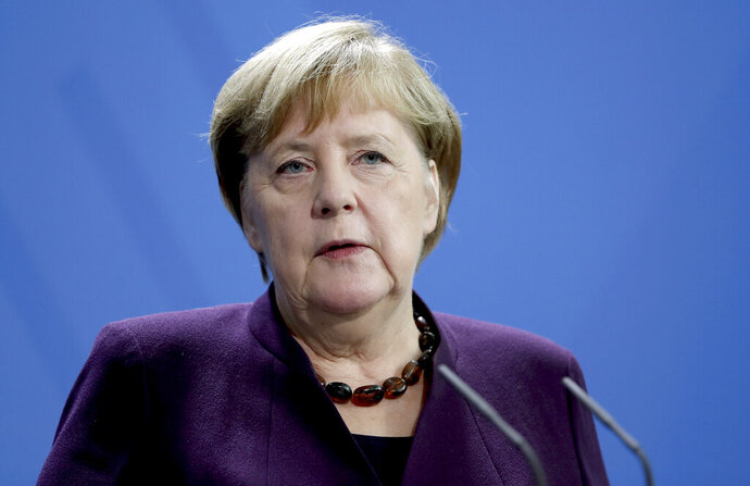 German Chancellor Angela Merkel addresses the media during a joint press conference as part of a meeting with Republic of Congo's President Felix Tshisekedi at the chancellery in Berlin, Germany, Friday, Nov. 15, 2019. (AP Photo/Michael Sohn)