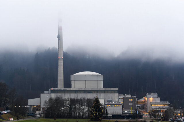 Exterior view of the Muehleberg nuclear power plant in Muehleberg, Switzerland, Friday, 20 Dec. 2019. Switzerland is shutting down one of its oldest nuclear power plants after 47 years of operation. The Muehleberg Nuclear Power Plant near the capital Bern is being taken off the grid shortly after noon Friday. (Anthony Anex/Keystone via AP)